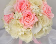 Model: TUPI01 This wedding flower package is made with peach Daisies, ivory open Roses, decorated with ivory and peach Rock Cress.  >>> Ribbon