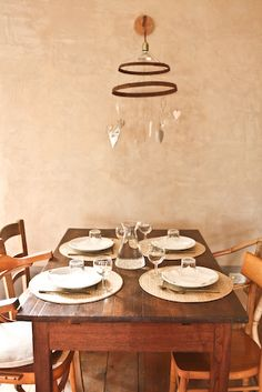 wood dining table and rustic metal lamp