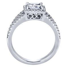 14k white gold 1.32cttw princess cut halo diamond engagement ring with prong set side diamonds and split shank design for a 1ct princess cut center. A square halo perfectly fits and 1ct priness cut di