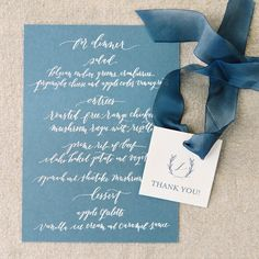 I love it when clients choose colored papers for their wedding stationery - it feels unexpected! This menu combo of lake blue paper + white lettering from a wedding with @mckenzie_powell is one of my all time favs! Also how adorable are those little gift tags?! Loved working on this project with sweet McKenzie - everything she touches is 👌🏼 Image by @scottomalley & @ashleeomalley