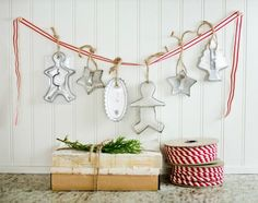 Hang holiday cookie cutters from a red and white ribbon in the kitchen for an easy and festive decoration.