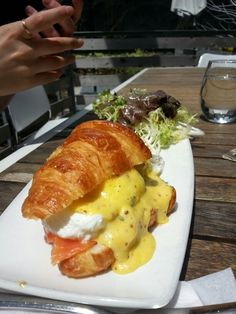 Crispy tender buttery croissant with runny poached eggs and rich hollandaise with house smoked salmon.