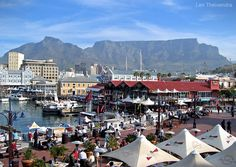 V&A Waterfront Incorporating an up-scale shopping complex, a world of restaurants, markets, an amphitheatre for outdoor events surrounded by numerous hotels, the V&A Waterfront is a Cape Town favourite. Photo by Len Theivendra. V&a Waterfront, Waterfront Restaurant, Waterfront Property, Most Beautiful Cities, Wonderful Places, Cape Town South Africa, Kwazulu Natal, Table Mountain, Out Of Africa