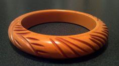 Vintage Carved Butterscotch Bakelite Bracelet by PotsandPetticoats, $59.00