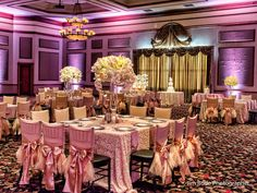Luxe Petals provided linens and florals for this setup of wedding tables at the Ruthe Jackson Center. Ambient light photography by Jim Rode