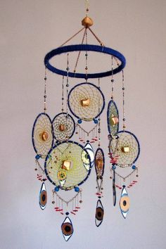 Stunning Dream Catcher Ideas to get only Pleasant Dreams Dream Catchers are Widely Used as Home Decor.Here are Some Handpicked Dream Catcher Ideas to Protect You from Bad Dreams,Nightmares,Negativity Making Dream Catchers, Dream Catcher Mobile, Handmade Crafts, Diy And Crafts, Arts And Crafts, Dreams Catcher, Los Dreamcatchers, Beautiful Dream Catchers, Medicine Wheel