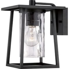 The Lodge - 1 Light Wall Sconce by Quoizel Lighting features a simplistic design with unique glass, features a look that's all its own. Its distinctive clear hammered glass is showcased by the simple framework which is highlighted with a Mystic Black finish. Visit PatioProductsUSA.com to purchase now! #lightwallsconce #outdoorlightwallsconce #porchlighting Contemporary Outdoor Wall Lights, Black Outdoor Wall Lights, Outdoor Wall Lantern, Outdoor Wall Sconce, Outdoor Wall Lighting, Wall Sconce Lighting, Outdoor Walls, Wall Sconces, Lighting Ideas