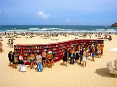 "Books on Bondi   Amanda writes: ""Bondi Beach in Sydney ... a furniture store ... set up this display of bookshelves and organized a 'book swap'. """