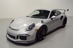 2016 Porsche 911 GT3 RS, Only 232 Miles, Asking $370,000.00, GT Silver Metallic/Black Leather Interior/GT Silver (Alcantara), Extended Range Fuel Tank, 23.9 Gallons, PCCB, Front Axle Lift System, Sound Package Plus, Fire Extinguisher, Light Design Pkg., Sport Chrono Package, Floor Mats, Door Panel/Leather/Alcantara, Pedals/Footrest/Aluminum, Porsche Communication Management/Navigation Module, Wheels Painted/Satin Black, LED Headlights/Black/Porsche Dynamic Light System,
