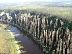 Russia, the Lena River is marked by spectacular rock pillars that reach a height of approximately 100 m. They were produced by the region's extreme continental climate with an annual temperature range of almost 100 degrees Celsius. The pillars form rocky buttresses isolated from each other by deep and steep gullies developed by frost shattering directed along intervening joints. Penetration of water from the surface has facilitated cryogenic processes (freeze-thaw action),