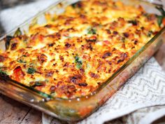 Cheesy Eggplant Bake Recipe Main Dishes with eggplant, olive oil, salt, pepper, onions, garlic, small tomatoes, roasted tomatoes, fresh spinach leaves, ricotta cheese, shredded mozzarella cheese, grated parmesan cheese