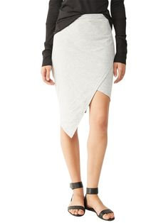 A fashion-forward cut on a classic mid-length style, this Cotton Modal skirt features asymmetric front slit paneling.