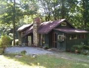 Surprising log cottage, tucked away in the mountains, overlooking a beautiful pond.