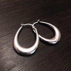"""Sterling Silver Earrings Stamped """"925"""".   This is not a stock photo. The image is of the actual article that is being sold  Sterling silver is an alloy of silver containing 92.5% by mass of silver and 7.5% by mass of other metals, usually copper. The sterling silver standard has a minimum millesimal fineness of 925.  All my jewelry is solid sterling silver. I do not plate.   Hand crafted in Taxco, Mexico.  Will ship within 2 days of order. Jewelry Earrings"""