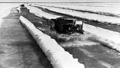 The city of LENINGRAD BLOCKADE.Way of life on the ice of Lake Ladoga. The ice is already melting, but the brave truckers carrying and carrying bread in besieged Leningrad. March 1942.
