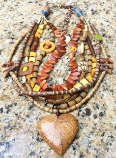 Exotic Natural Bone and Amber Multi-Strand Heart Pendant Necklace