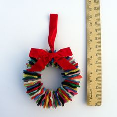 Rescued Wool Wreath - Multi with Rich Red Velvet Ribbon - recycled wool wreath by alicia todd. $16.99, via Etsy.