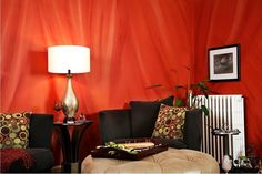 The Texture On Wall Reminds Us Of Floating Drapes Vibrant Orange Makes Room Interior Design JobsIn