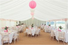 Wedding recption marquee decked out with pink & peach colour detail