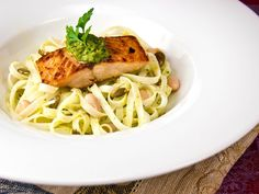 Pumpkin-Seeds Pesto over Salmon, Rice-Noodles and White Beans  by RecipeTaster