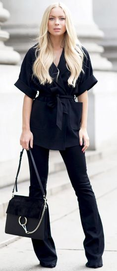 Total Black Wrap Blouse And Flare Jeans Fall Street Style Inspo by Victoria Tornegren