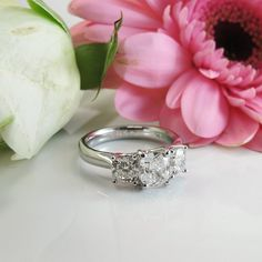 Cushion Cut Trilogy engagement ring from York Jewellers