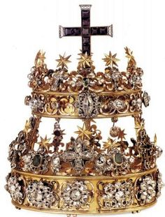 Double crown. c1620-1720. Made of Gold, silver, diamonds, emeralds, rubies, sapphires, amethysts, quartz and enamel. In Italy - Piedmont - Sanctuary of Oropa - Savoia Royal Apartments - King's Room. Made according to a design attributed to Filippo Juvarra, by the jeweler Bertollero of Turin which dissassembled a previous crown made in 1620. The crown , like the previous one, consists of two superimposed crowns....