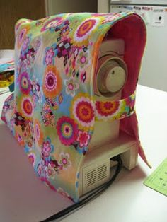 """Reversible Sewing Machine Cover..."" the real question is... why? why do you need this? stupid and unnecessary, folks."