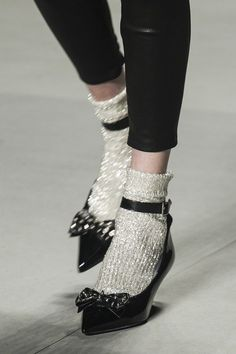 Saint LaurentGlitter socks and stilettos garnished with a bow - who can resist?
