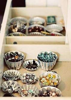Mini Vintage Baking molds are great for sorting your pieces in a drawer. Via Paisley Wallpaper.