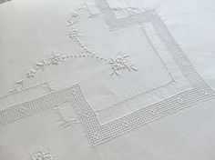 White on white--pulled thread work.