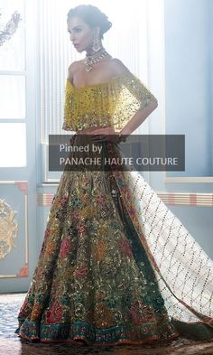 This lehenga skirt featured in Fawn color net fabric heavily embroidered in floral patterns with resham, dabka, zari and beads. Blouse of this wedding lehenga is also in offshoulder style in yellow colour with multicolour sequins. Dupatta is in fawn colour net with heavy mukaish work and four-sided embroidered border. Note - Blouse can be customised in any style of your choice.