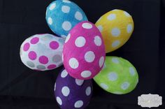 DIY Paper mache' Easter eggs ... uses water balloons... http://www.peridotskys.com/2012/04/diy-paper-mache-easter-eggs.html#