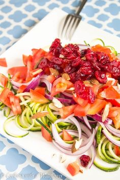 Zucchini noodles topped with tomatoes, almonds, cranberries, and red onions then tossed with honey dijon mustard dressing.