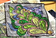 Crayon Batik.  Paint with melted crayons and dye fabric in black dye.