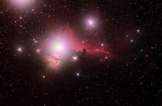 Astronomers Baffled By Strange Object Near Center Of Milky Way A widefield view of the Flame and Horsehead Nebulae in Orion, captured in December by astrophotographer Roger Hutchinson. The pair are approximately 900 to light years a Horsehead Nebula, Orion Nebula, Andromeda Galaxy, Space Photos, Space Images, Cosmos, Spitzer Space Telescope, Saturns Moons, Whirlpool Galaxy