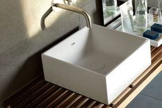 Hastings 15 x 15 x 5 1/2 vessel sink.  Build cabinet around this.