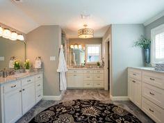Bathroom walls in soft green, white cabinets. HGTV Bathroom Flips, 20 Best Fixer Upper Rooms via A Blissful Nest
