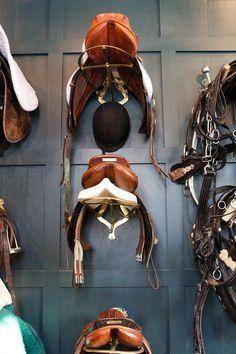 Metal wall mounted saddle rack.