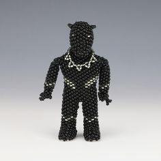 """This marvelous Black Panther was hand beaded by award winning artists, Farlan and Alesia Quetawki. Signed 3 1/8"""" tall x 1 3/4"""" long x 7/8"""" wide Artist card included"""