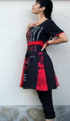 red and black recycled dress tunic. made from recycled clothing. Ecofriendly. Remade and reused. Very comfortable, Perfect to pants. One of a kind.  Size: M-L (streching)  Bustline: 38 inches (96 cm)  Waist: max 36 inches (90 cm)  Hips line: max 42 inches (106 cm)  length: 37 inches (94 cm)  Please, iron on the left size!!!  wash separately in rather cool water.