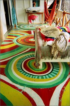 swirly painted porch floor! I would love to do this cleanly (stencils or something) on a side table!