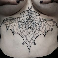 Underboob bat tattoo