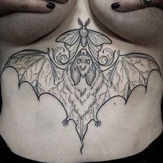 Underboob bat tattoo