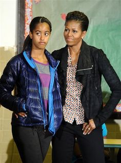 First Lady Michelle Obama, in a casual print top, textured leather jacket and dark jeans, and daughter Malia listen as President Obama speaks to volunteers at the Browne Education Center in Washington on Monday. Barack Obama Family, Malia Obama, Obamas Family, Barrack And Michelle, Michelle And Barack Obama, Presidents Wives, Black Presidents, Obama Daughter, First Daughter
