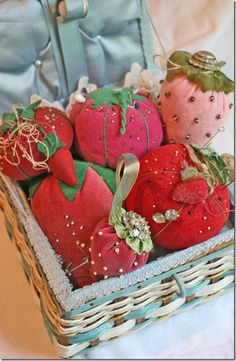 Vintage sewing basket filled with strawberry pincushions