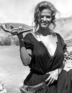 Claudia Cardinale | desert | gun | trick | cowgirl | fun | beauty | movie set | juggle | www.republicofyou.com.au