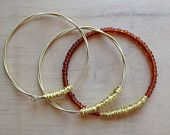 Set of 3 Eco Friendly gold Guitar string bangles with beading, wrapped with gold wire.