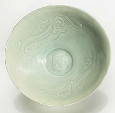 A carved Qingbai 'Chilong' bowl, Song dynasty