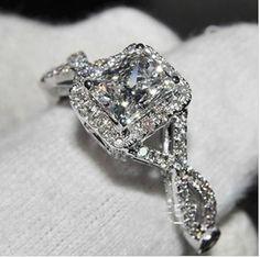 A Perfect 3.7TCW Emerald Cut Russian Lab Diamond Infiniity Twist Diamond Band